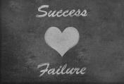 Love Success and Failure with a heart shape blackboard