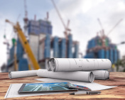 blueprints and tablet in the construction site