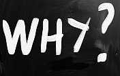 'Why' handwritten with white chalk on a blackboard
