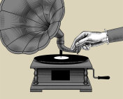 Woman's hand with old gramophone