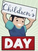Smiling Boy Holding a Sign Celebrating Children's Day