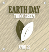 Earth Day poster on wooden background with leafs