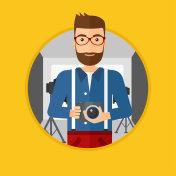 Photographer with camera in photo studio