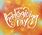 thanksgiving day lettering  on blur autumn background with flares