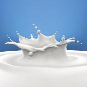 Big milk splash on blue gradient background