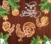 Christmas gingerbread on wooden background