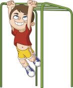 Boy climbs monkey bars