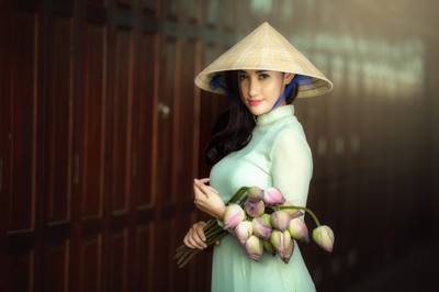 Beautiful woman wearing hat  in white Ao dai Vietnam  Traditiona