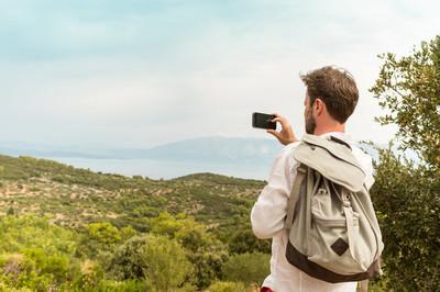 旅游的人,把美丽的风景照片