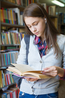 Girl student reads  book