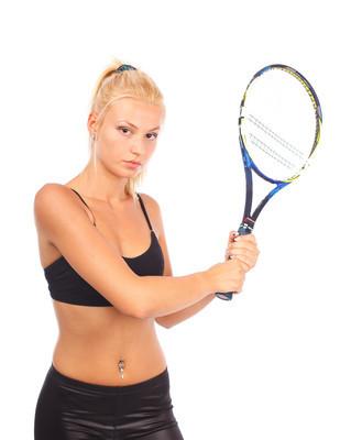 网球拍的年轻女人