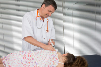 Male  doctor giving vaccination girl, health, prevention