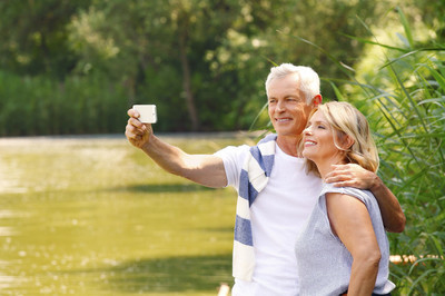 Senior couple take self portrait with mobile