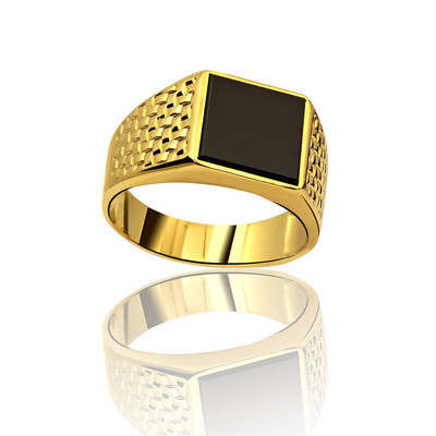 Men's gold ring on a white background