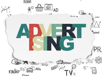广告概念: 广告撕破纸张背景上