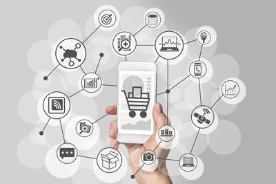Mobile shopping experience with hand holding smartphone to connect to online shops to purchase consumer goods