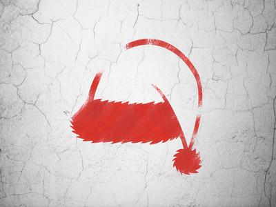 假日的概念︰ 在背景墙上的圣诞帽子