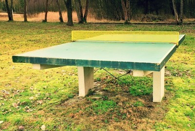 Outdoors green  concrete ping pong table in camp