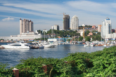 Sailing boats and high rise residential buildings in Vladivostok,  Russia