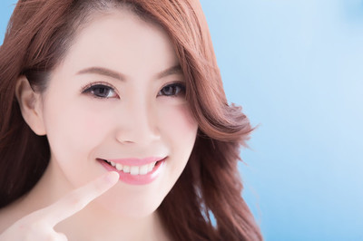 Woman with healthy teeth  smiling