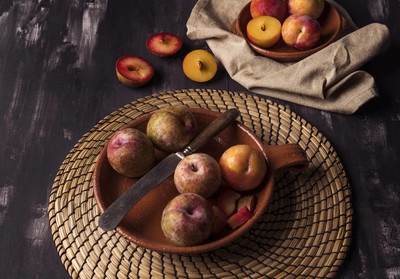 Plums pieces in dark textured  table