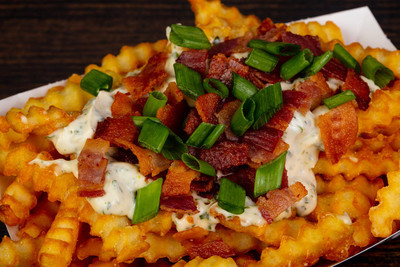 Fried potato with bacon and sauce