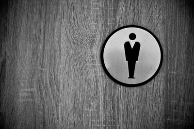 The men's toilet sign on wooden door