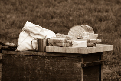 Bread with butter on cutting board (sepia)