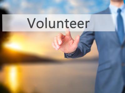 Volunteer -  Businessman click on virtual touchscreen.