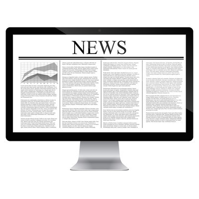 Computer  with news article on screen
