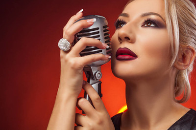 Close-up  woman with microphone