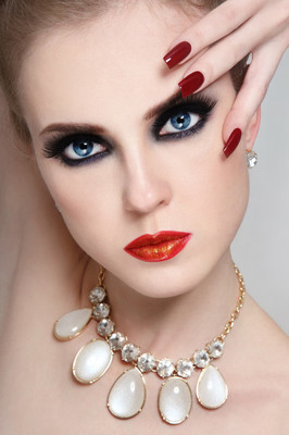 Woman with smoky eyes and long nails