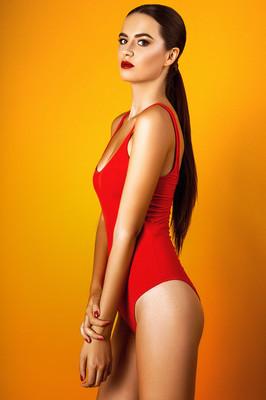 Studio photo of young  woman on yellow background