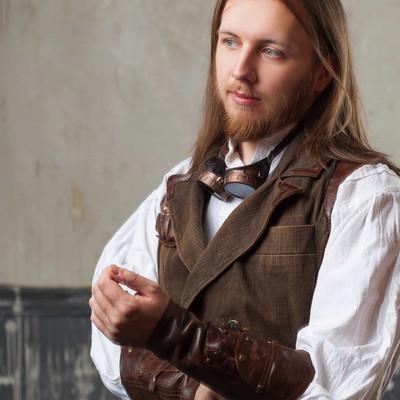 英俊的男性蒸汽朋克。复古男人肖像 grunge 的背景