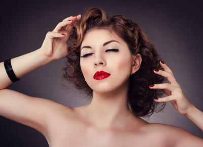 Woman with red sexy lips and nails