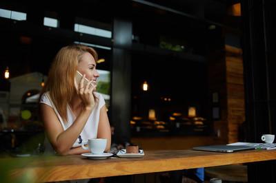 Pretty woman talking mobile phone