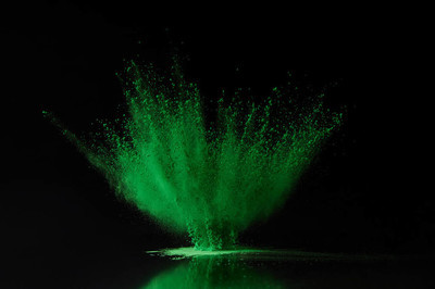 green holi powder explosion on black, Hindu spring festival