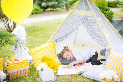 Cute Little girl and   tent