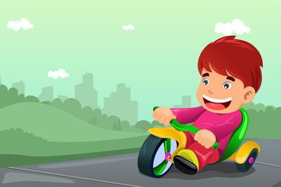 男孩骑三轮车