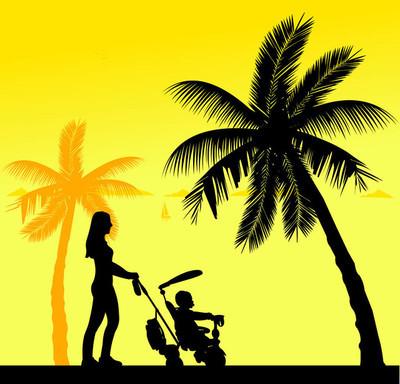 母亲与她的孩子走在海滩上的一辆三轮车上